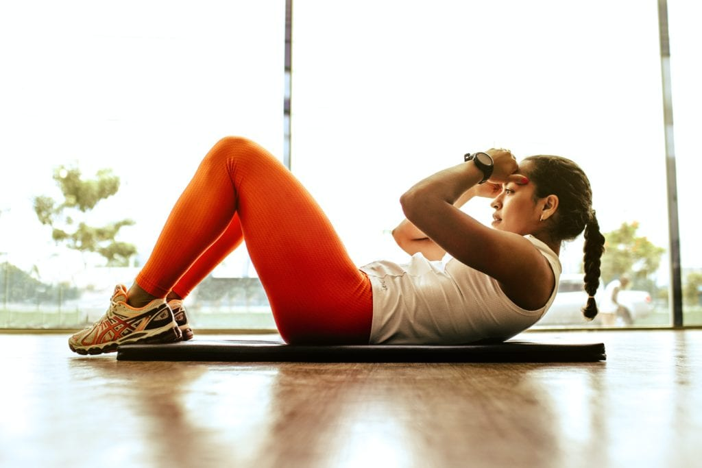 Woman On The Floor Doing Crunches