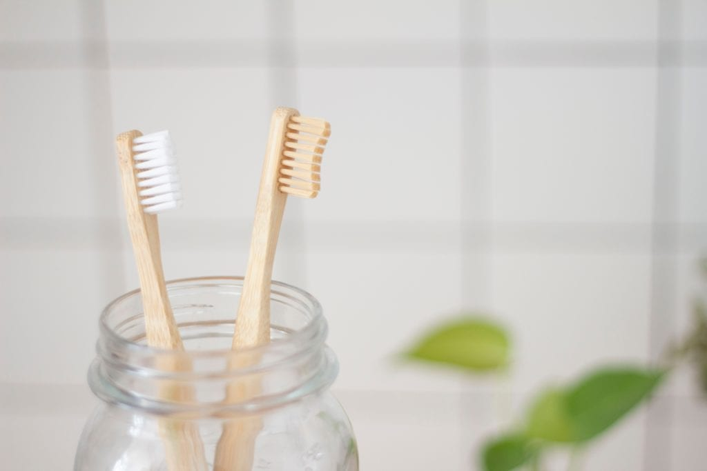 Two Toothbrushes In A Jar