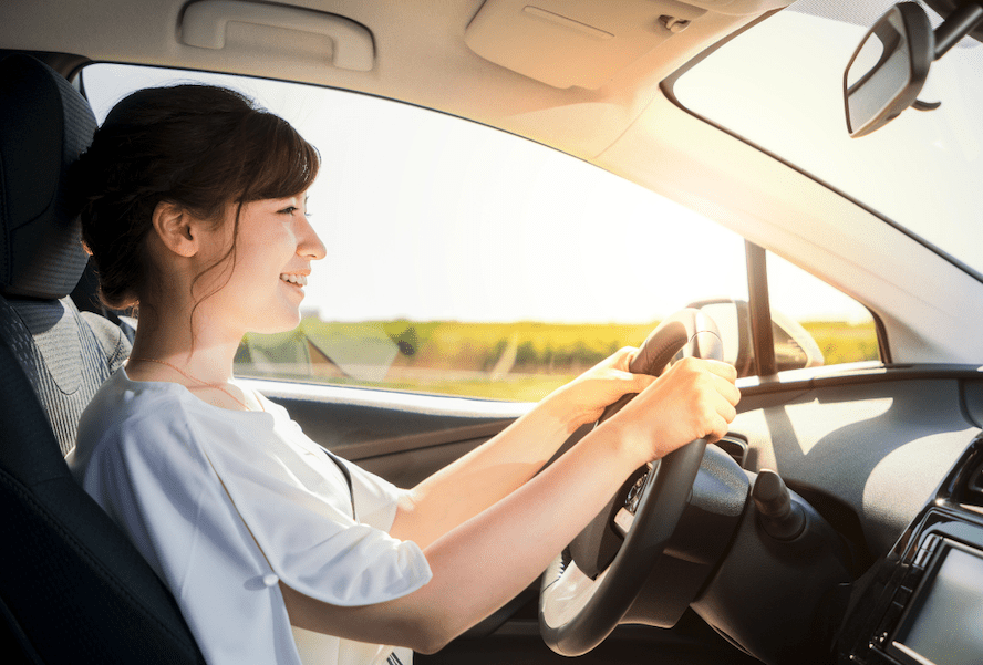 Woman Looks At The Road Ahead While Driving Car