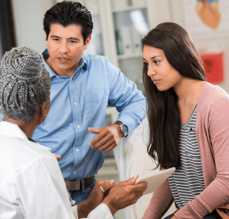 Father Asks Doctor Questions At Daughters Consultation